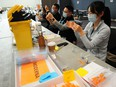 Clinic staff prepare vaccines during an immunization event in Vancouver last month.