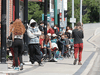 People line up outside a COVID-19 vaccination walk-in clinic in Winnipeg, June 22, 2021.