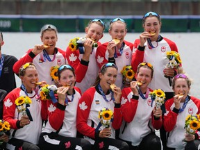 Gold medalists Lisa Roman, Kasia Gruchalla-Wesierski, Christine Roper, Andrea Proske, Susanne Grainger, Madison Mailey, Sydney Payne, Avalon Wasteneys and Kristen Kit of Canada pose during the medal ceremony for the women's rowing eight final lat the 2020 Summer Olympics, Friday, July 30, 2021, in Tokyo, Japan.
