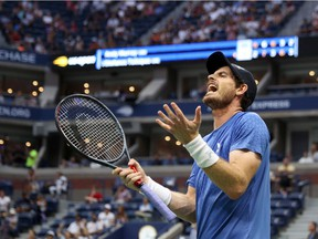 Andy Murray of United Kingdom reacts against Stefanos Tsitsipas of Greece during their men's singles first round match on Day One of the 2021 US Open at the Billie Jean King National Tennis Center on August 30, 2021 in the Flushing neighborhood of the Queens borough of New York City.