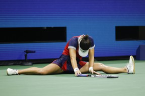 Bianca Andreescu of Canada is seen on the ground as she plays against Maria Sakkari of Greece during her Women's Singles round of 16 match on Day Eight of the 2021 US Open at USTA Billie Jean King National Tennis Center on September 6, 2021 in the Flushing neighborhood of the Queens borough of New York City.