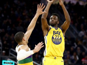 Warriors' Andrew Wiggins shoots over Josh Hart of the Pelicans at Chase Center in San Francisco, Feb. 23, 2020.