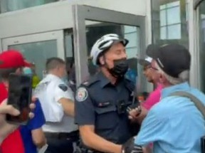 Two people face charges after an anti-vaccine protest at Yonge and Dundas Sts.