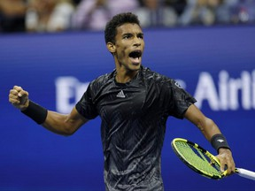 Felix Auger-Aliassime reacts against Carlos Alcaraz during his quarterfinal match of the U.S. Open at the USTA Billie Jean King National Tennis Center in New York City, Tuesday, Sept. 7, 2021.