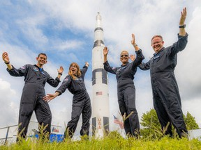"""In this July 1, 2021, photo courtesy of Netflix, the Inspiration4 crew (L-R) Jared Isaacman, Hayley Arceneaux, Sian Proctor and Chris Sembroski pose for a photo. - The Inspiration4 mission, which will be the first to send only civilians into space for several days aboard a SpaceX rocket, will be available to watch in """"near real time"""" in a documentary series on Netflix, the streaming platform announced on August 19, 2021."""