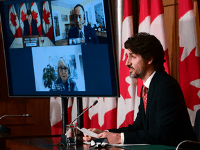 Prime Minister Justin Trudeau, holding a news conference with health officials in February on the vaccine rollout. By September, mandatory vaccinations was a major talking point in election campaigns.