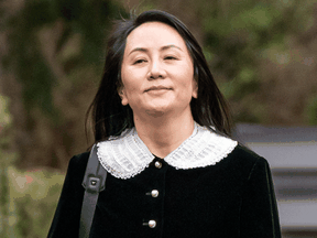 Meng Wanzhou, chief financial officer of Huawei, leaves her Vancouver home for an appearance at B.C. Supreme Court in April.