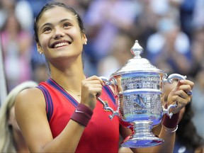 Emma Raducanu of Great Britain celebrates with the championship trophy after her match against Leylah Fernandez of Canada (not pictured) in the women's singles final on day thirteen of the 2021 U.S. Open tennis tournament at USTA Billie Jean King National Tennis Center.