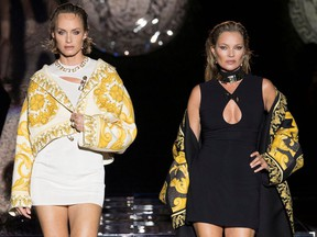 Models Amber Valletta and Kate Moss present creations from the Versace by Fendi collection during Milan Fashion Week in Milan, Italy, September 26, 2021.