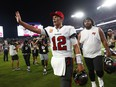 Tampa Bay Buccaneers quarterback Tom Brady (12) and defensive tackle Vita Vea (50) celebrate after defeating the Dallas Cowboys at Raymond James Stadium.