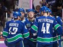 The lessons of Brock Boeser (centre), who came out of the gate slowly to start the 2019-20 season, could be instructive for restricted free agent stars Quinn Hughes and Elias Pettersson.