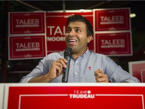 Vancouver Granville Liberal candidate Taleeb Noormohamed leads NDP candidate Anjali Appadurai by just 230 votes as they await the counting of mail-in ballots.