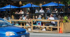 Outdoor patios like this one outside Havana on Commercial Drive could become permanent summer fixtures in Vancouver.