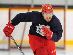 Wade MacLeod digs in during his regular workout at Planet Ice Coquitam this week. 'If I go back and I don't have what I once had, that's fine,' the multiple cancer survivor says of his return to professional hockey with the England-based Manchester Storm. 'But I feel like I'm fit and ready to go and my skills are there.'