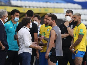 Argentina's Lionel Messi and Brazil's Neymar are seen as play is interrupted after Brazilian health officials objected to the participation of three Argentine players they say broke quarantine rules.