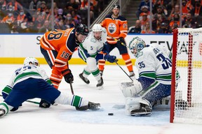 Zach Hyman of the Edmonton Oilers takes a shot against goaltender Thatcher Demko of the Vancouver Canucks during the second period at Rogers Place on Wednesday.