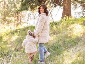 Jillian Harris and her daughter Annie wear the faux-fur jacket from her latest collaboration with Joe Fresh.