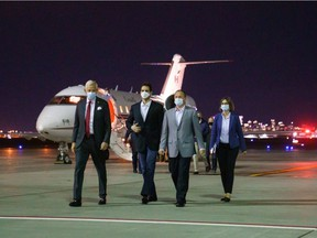 Prime Minister Justin Trudeau welcomes Michael Kovrig and Michael Spavor back to Canada at the Calgary airport.