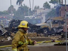 Fire crews work the scene of a small plane crash, Monday, Oct. 11, 2021, in Santee, Calif.
