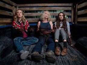 """From left: Judy Greer, Jamie Lee Curtis and Andi Matichak in """"Halloween Kills."""" MUST CREDIT: Ryan Green/Universal Pictures"""