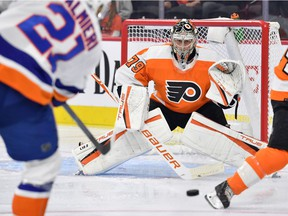 New York Islanders right wing Kyle Palmieri (21) shoots the puck at Philadelphia Flyers goaltender Carter Hart (79) during the first period at Wells Fargo Center in September.