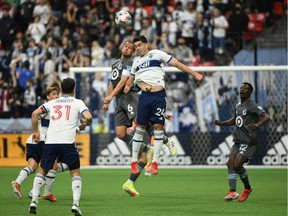 Minnesota United FC midfielder Osvaldo Alonso (6) goes up for a header against Vancouver Whitecaps forward Brian White (24) during the first half at B.C. Place.