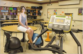 Allison Cameron, a resource teacher at Evan Hardy Collegiate, sits in her classroom that is equipped with exercise machines for students.