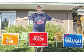 Brian Krzyzaniak can't decide who to vote for in the federal election and has signs for three candidates on his lawn.