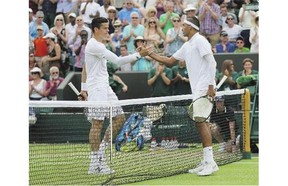 Canada's Milos Raonic, left, congratulates Nick Kyrgios of Australia following third-round singles action at Wimbledon on Friday. Kyrgios won the match in four sets.