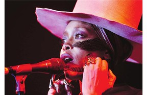 Erykah Badu performs at the Essence Festival in New Orleans, Sunday, July 6, 2014.
