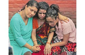 Family members of Laxman Neupane, one of the police officers killed in Monday's clashes in western Nepal, mourn after his body was brought to Kathmandu on Tuesday.