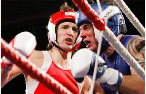 Liberal MP Justin Trudeau, left, fights Conservative Senator Patrick Brazeau during charity boxing match for cancer research Saturday, March 31, 2012 in Ottawa .