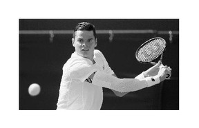 Milos Raonic returns a shot to Daniel Gimeno-Traver of Spain during a first-round match at Wimbledon on Monday.
