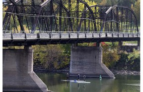 Three paddleboarders took a moment to check out the underside of Traffic Bridge as they enjoyed the sunny weather on Thursday, September 24.