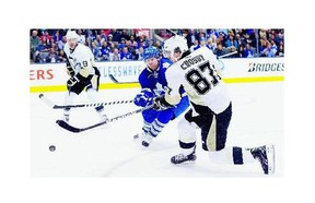 Pittsburgh Penguins' Sidney Crosby, right, could be setting up former Leafs forward Phil Kessel, who was traded to the Penguins in a six-player deal on Wednesday.