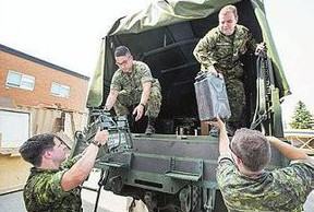 Reservists prepare to leave Hugh Cairns Armoury in Saskatoon to fight wildfires in northern Saskatchewan.