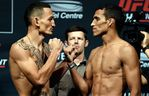 SASKATOON, SK - AUGUST 22: (L-R) Opponents Max Holloway of the United States and Charles Oliveira of Brazil face off during the UFC weigh-in at the SaskTel Centre on August 22, 2015 in Saskatoon, Saskatchewan, Canada. (Photo by Jeff Bottari/Zuffa LLC/Zuffa LLC via Getty Images)