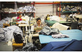 A woman works at an Endy Sleep mattress factory in Toronto. The company, which sells mattresses online and delivers to your door, hopes to grab a piece of the growing market by cutting out the middleman.