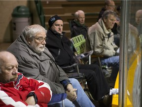 PJ Kennedy watches the game from a lawn chair at Rutherford Rink on the University of Saskatchewan campus on Oct. 31, 2015.