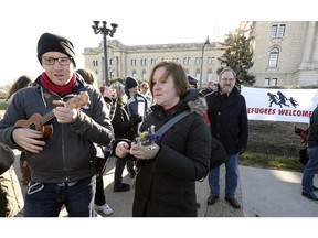 Protesters at the legislature called on Premier Wall to reverse his go-slow stance on refugees.