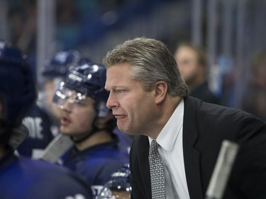 Saskatoon Blades head coach Bob Woods expresses his disagreement with a delay of game penalty while his team takes on the Edmonton Oil Kings in second period WHL action, November 28, 2015.