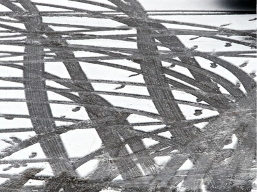 Tracks in the snow tell a tale of people walking after parking on November 18, 2015 in Saskatoon.