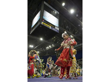 A dancer takes part in the opening ceremonies  during the Federation of Saskatchewan Indian Nations (FSIN) Cultural Celebration and Pow Wow at SaskTel Centre in Saskatoon, November 15, 2015.