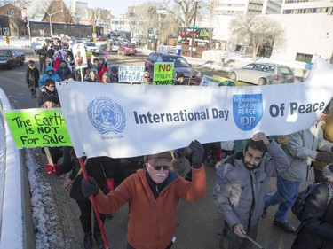People walk down the Broadway Bridge during a march and rally for the climate called Saskatoon2Paris, November 29, 2015.