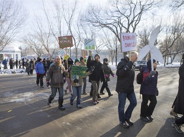 People walk down 20th Street East during a march and rally for the climate called Saskatoon2Paris, November 29, 2015.