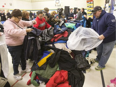 Hundreds of coats and warm winter accessories were collected through the Rock 102 Coats for Kids Campaign this year and were on display during a news conference at St. Michael school, November 19, 2015. Representatives from inner-city and community schools were given the chance to fill bags for their schools.