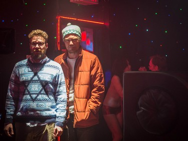 """Seth Rogen as Isaac (L) and Michael Shannon as Mr. Green in Columbia Pictures' """"The Night Before."""""""