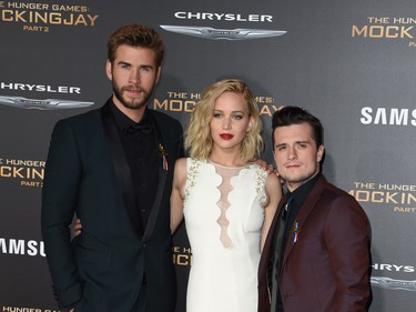 """L-R: Actors Liam Hemsworth, Jennifer Lawrence and Josh Hutcherson arrive for the premiere of Lionsgate's """"The Hunger Games: Mockingjay - Part 2"""" at Microsoft Theatre in Los Angeles, California, November 16, 2015."""