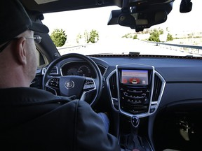 Virginia Tech Center for Technology Development Program administration specialist Greg Brown behind the wheel of a driverless car during a test ride.