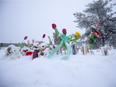 A memorial just outside of the school grounds still sits after Friday's school shooting at La Loche Community School on Sunday, January 24, 2016.
